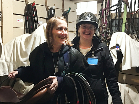 2 women in a tac room at horse stable