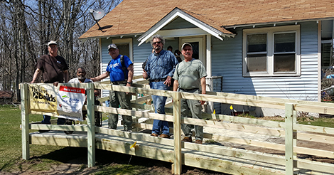 Michael and group of volunteer builders on new ramp