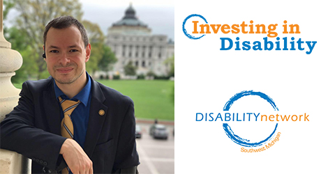 "Andrei with capital building in background. Text: ""Investing In Disability"""