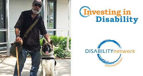 "Mike & Trin (dog). Text: ""Investing In Disability"""