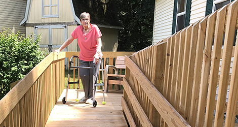 Woman using walker on ramp