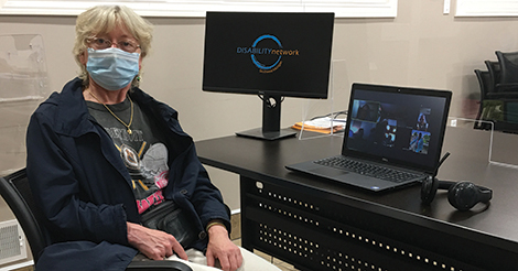 woman at computer wearing face mask