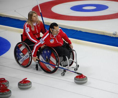 man and women in wheelchairs curling
