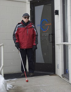 blind man using a white cane