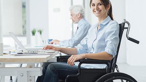 young woman in wheelchair at a computer